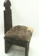 Ethiopian hand carved wooden chair with animal skin cushion